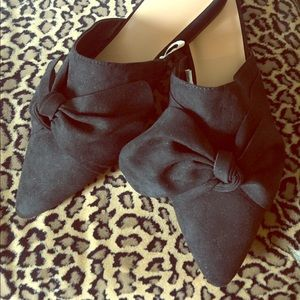 'A new day' black bow mules.